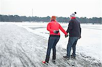 Couple ice skating, holding hands Stock Photo - Premium Royalty-Freenull, Code: 649-07438002