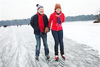 Couple ice skating, holding hands Stock Photo - Premium Royalty-Freenull, Code: 649-07438003
