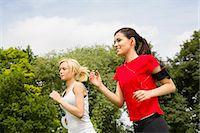 Women jogging through park Stock Photo - Premium Royalty-Freenull, Code: 649-07438058