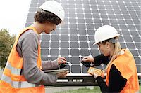 solar power - Man and woman working on photo voltaic panels Stock Photo - Premium Royalty-Freenull, Code: 649-07438157