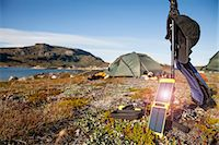 solar power - Solar charger with tent in background at campsite Stock Photo - Premium Royalty-Freenull, Code: 698-07439475