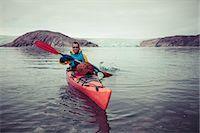 Portrait of happy mature man kayaking on sea Stock Photo - Premium Royalty-Freenull, Code: 698-07439486