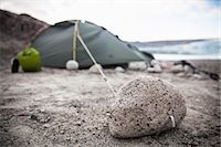 View of stone with camping tent in background Stock Photo - Premium Royalty-Freenull, Code: 698-07439487