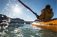 Rear view of mature woman kayaking on sea Stock Photo - Premium Royalty-Freenull, Code: 698-07439493