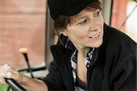 Female farmer driving tractor Stock Photo - Premium Royalty-Freenull, Code: 698-07439555