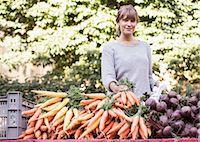 Portrait of smiling female vendor selling vegetables at market stall Stock Photo - Premium Royalty-Freenull, Code: 698-07439641