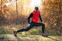stretching (people exercising) - Full length of man doing stretching exercise in forest Stock Photo - Premium Royalty-Freenull, Code: 698-07439742
