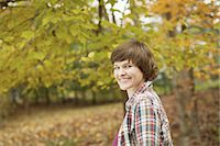 A woman in woodland on an autumn day. Stock Photo - Premium Royalty-Freenull, Code: 6118-07439805