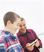 A day out at Ashokan lake. Two boys looking at a cell phone screen. Stock Photo - Premium Royalty-Freenull, Code: 6118-07440274