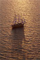 sports and sailing - A three-masted sailing ship with full sail on the Aegean Sea at sunset. Stock Photo - Premium Royalty-Freenull, Code: 6118-07440522