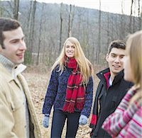 A group of four people outdoors on a winter day. Stock Photo - Premium Royalty-Freenull, Code: 6118-07440781