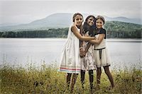 Three young girls standing by the side of a lake, hugging each other. Stock Photo - Premium Rights-Managed, Artist: Mint Images, Code: 878-07442514