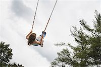 swing (sports) - A girl on a rope swing, high in the air Stock Photo - Premium Rights-Managednull, Code: 878-07442517