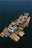 Rainforest lumber loaded on freighter, an aerial view of the timber on rafts and on board, in Sandakan, Borneo Stock Photo - Premium Rights-Managednull, Code: 878-07442620