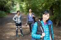 Three young female hikers on country road Stock Photo - Premium Royalty-Freenull, Code: 614-07444009