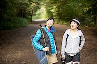 Two young female hikers on country road Stock Photo - Premium Royalty-Freenull, Code: 614-07444010