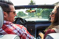 Young couple in convertible, San Diego, California, USA Stock Photo - Premium Royalty-Freenull, Code: 614-07444032