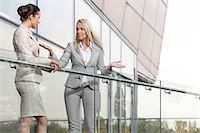 Young businesswoman arguing with female colleague at office balcony Stock Photo - Premium Royalty-Freenull, Code: 693-07444473