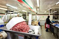 Minced meat in container with employee standing in background at store Stock Photo - Premium Royalty-Freenull, Code: 693-07444546