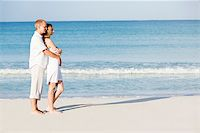 happy young couple in love having fun on the beach blue sky and sunshine Stock Photo - Royalty-Freenull, Code: 400-07445350