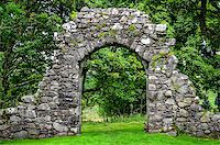 Old stone entrance wall in green landscaped garden Stock Photo - Royalty-Freenull, Code: 400-07449848