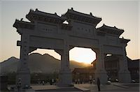 Sunset at the entrance gate to Shaolin temple, birthplace of Kung Fu martial art, Shaolin, Henan Province, China, Asia Stock Photo - Premium Royalty-Freenull, Code: 6119-07452369