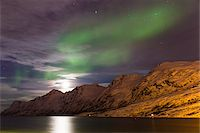 sky stars - Starry sky with Northern Lights (Aurora Borealis) and moon illuminating snow covered mountains at a fjord in the Arctic, Norway Stock Photo - Premium Royalty-Freenull, Code: 600-07453772