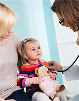 Doctor using Stethoscope on Baby Girl with Mother in Doctor's Office Stock Photo - Premium Rights-Managed, Artist: Uwe Umstätter, Code: 700-07453706