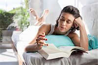 sole - woman lying on the bed, reading book Stock Photo - Premium Royalty-Freenull, Code: 613-07454186
