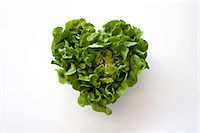 Heart-shaped formed by fresh Lettuce Stock Photo - Premium Royalty-Freenull, Code: 613-07454513