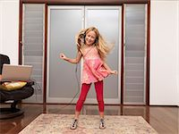 preteen dancing - Young girl at home dancing to music Stock Photo - Premium Royalty-Freenull, Code: 613-07454562
