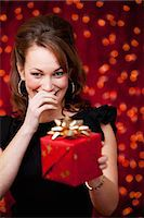 present wrapped close up - Christmas: Giggling Woman Offers Present Stock Photo - Premium Royalty-Freenull, Code: 6106-07455288
