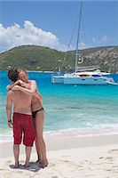 Couple hugging on the beach Stock Photo - Premium Royalty-Freenull, Code: 6106-07455364