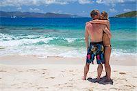 Couple standing on beach Stock Photo - Premium Royalty-Freenull, Code: 6106-07455454