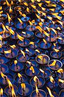 Prayer Candles Stock Photo - Premium Royalty-Freenull, Code: 6106-07455499