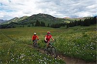 people mountain biking - Couple mountain biking in high mountains Stock Photo - Premium Royalty-Freenull, Code: 6106-07455517