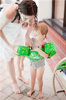 Mather with daughter at swimming pool Stock Photo - Premium Royalty-Freenull, Code: 6102-07455793