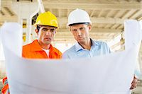 professional (pertains to traditional blue collar careers) - Male architects reviewing blueprint at construction site Stock Photo - Premium Royalty-Freenull, Code: 693-07456128