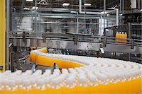 Packed bottles moving on conveyor belt Stock Photo - Premium Royalty-Freenull, Code: 693-07456324