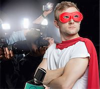 Superhero being photographed by paparazzi Stock Photo - Premium Royalty-Freenull, Code: 693-07456335