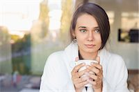 Sick young woman holding coffee mug at home Stock Photo - Premium Royalty-Freenull, Code: 693-07456395