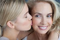 Daughter kissing smiling mother Stock Photo - Premium Royalty-Freenull, Code: 635-07456526