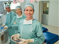 Surgeons preparing for surgery in operating room Stock Photo - Premium Royalty-Freenull, Code: 635-07456929