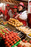 food stalls - Stall selling candied fruit sticks in the Night Market, Wangfujing Street, Beijing, China Stock Photo - Premium Rights-Managednull, Code: 841-07457240