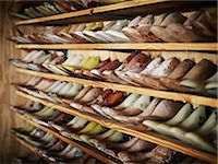 services - Shelves of boot lasts on wall in boot shop Stock Photo - Premium Royalty-Freenull, Code: 613-07459003