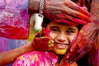 People smearing holi colours on a boy Stock Photo - Premium Royalty-Freenull, Code: 613-07459024