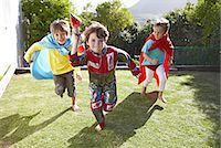 Boys playing together in a garden Stock Photo - Premium Royalty-Freenull, Code: 613-07459159