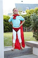 Boy pretending to be a super hero Stock Photo - Premium Royalty-Freenull, Code: 613-07459162