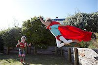Boys playing at being superheroes Stock Photo - Premium Royalty-Freenull, Code: 613-07459164