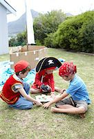 Boys playing pirates together Stock Photo - Premium Royalty-Free, Artist: Ikon Images, Code: 613-07459168